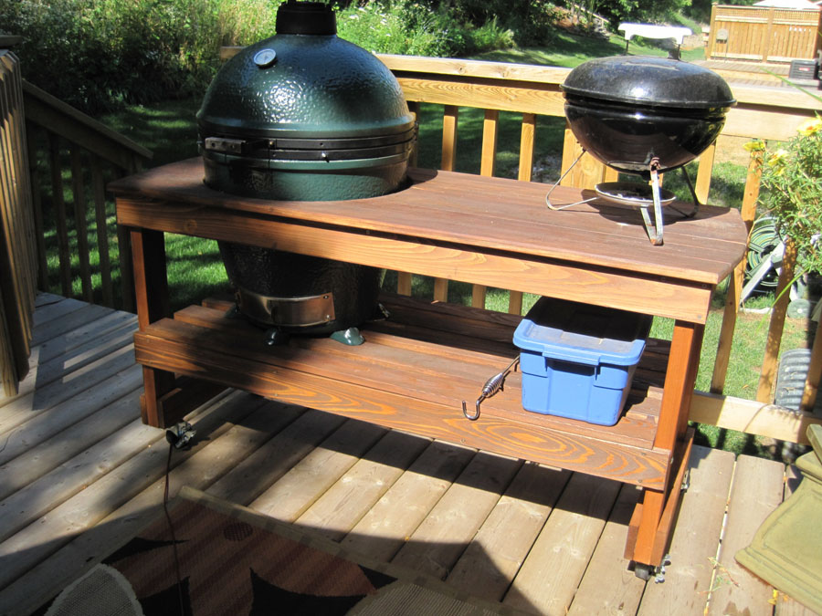 Big green egg in wooden table