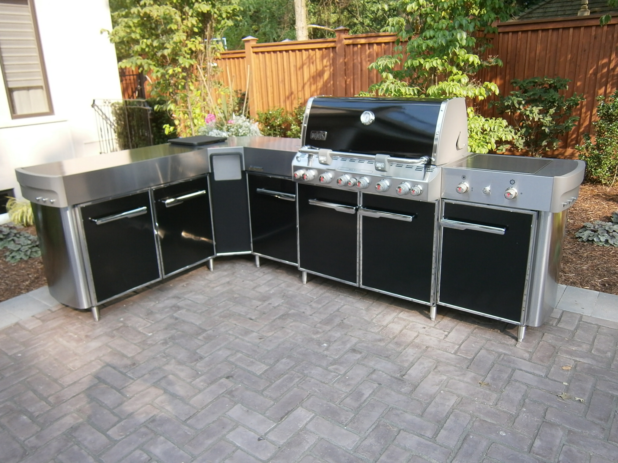weber summit grill island with social centre